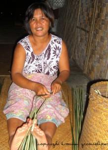 Heidi Munan mat weaver in longhouse